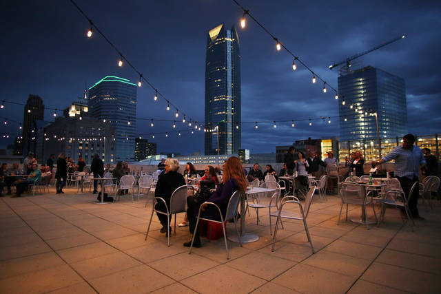 The crowd listens to Edgar Cruz and The Brave Amigos perform during OKCMOA's Thursday $5 After 5:00 on the Roof Terrace for live music, light food menu and drinks in downtown Oklahoma City, Thursday, April 27 , 2017. Photo by Doug Hoke, The Oklahoman.
